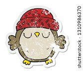 Stock vector distressed sticker of a cute cartoon owl in hat 1310986370