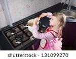 little girl in the kitchen... | Shutterstock . vector #131099270