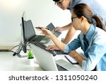 programmer work with developing ... | Shutterstock . vector #1311050240