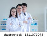 team of professional scientists ...   Shutterstock . vector #1311071093
