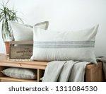 farmhouse style linen pillows... | Shutterstock . vector #1311084530