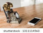 new and old telephone on the... | Shutterstock . vector #1311114563
