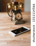new and old telephone on the... | Shutterstock . vector #1311114566