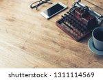 vintage typewriter on the... | Shutterstock . vector #1311114569