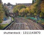 empty railway tracks near a... | Shutterstock . vector #1311143870
