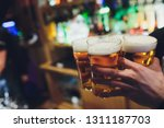 barman hands pouring a lager...   Shutterstock . vector #1311187703