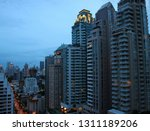 skyscrapers against cloudy... | Shutterstock . vector #1311189206