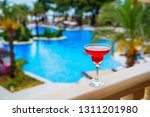 a glass of exotic tropical... | Shutterstock . vector #1311201980