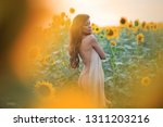 beautiful woman with long hair... | Shutterstock . vector #1311203216