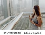 young woman drink white wine on ... | Shutterstock . vector #1311241286
