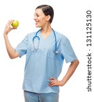 young doctor holding apple ...   Shutterstock . vector #131125130