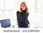 portrait of happy casual... | Shutterstock . vector #1311289310