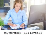 shot of young sales woman... | Shutterstock . vector #1311295676