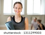 portrait of excited female yoga ... | Shutterstock . vector #1311299003