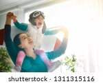 happy family is having fun at... | Shutterstock . vector #1311315116