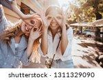 adorable girls posing on the... | Shutterstock . vector #1311329090