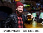 guy bearded man sit at bar... | Shutterstock . vector #1311338183