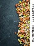 hazelnut  almonds  raisins ... | Shutterstock . vector #1311339686