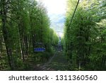 a blue chairlift in a deciduous ... | Shutterstock . vector #1311360560