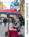 Small photo of Quebec, OCT 1: White hair old man playing harp in the beautiful Breakneck Steps area on OCT 1, 2018 at Quebec, Canada