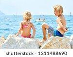 children girl and boy  siblings ... | Shutterstock . vector #1311488690