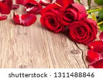 red roses on wooden background... | Shutterstock . vector #1311488846