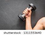 woman hand holding dumbbell on... | Shutterstock . vector #1311553640