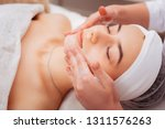 spa treatment. pleasant young... | Shutterstock . vector #1311576263