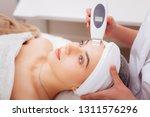 clean skin. joyful relaxed... | Shutterstock . vector #1311576296