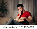 crying man watching tv eating... | Shutterstock . vector #1311584270