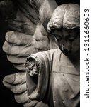 An Angel Statue With A Broken...