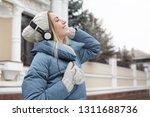young woman with headphones... | Shutterstock . vector #1311688736