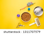 Stock photo pet cat food and accessories of cat life flat lay with space for design on yellow background 1311707579