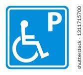blue parking sign for disabled... | Shutterstock .eps vector #1311715700