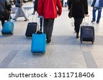travelers walking with luggage... | Shutterstock . vector #1311718406