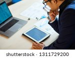 confused pensive businessman... | Shutterstock . vector #1311729200