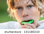 boy putting in his mouth guard | Shutterstock . vector #131180210