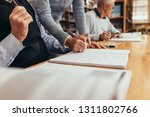 cropped shot of a lecturer... | Shutterstock . vector #1311802766