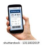 hand holding a black smart... | Shutterstock . vector #1311832019