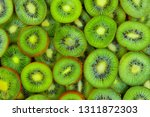 top view of heap of sliced kiwi ... | Shutterstock . vector #1311872303