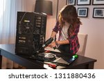 young woman using electrical... | Shutterstock . vector #1311880436