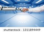 A Robot Hand And A Human Hand...