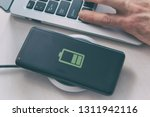 smartphone on a wireless... | Shutterstock . vector #1311942116