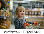 child in the store buys food   Shutterstock . vector #1312017320