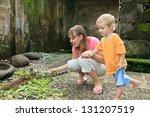 family feeding iguanas | Shutterstock . vector #131207519