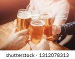 close up friends clinking... | Shutterstock . vector #1312078313