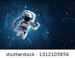 astronaut in outer space.... | Shutterstock . vector #1312105856
