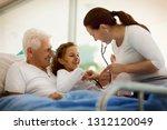 elderly man receiving a... | Shutterstock . vector #1312120049