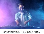 male dj playing music in club | Shutterstock . vector #1312147859