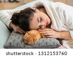 young woman with cute funny cat ... | Shutterstock . vector #1312153760